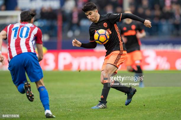 Carlos Soler of Valencia CF competes for the ball with Yannick Ferreira Carrasco of Atletico de Madrid during the match Atletico de Madrid vs...