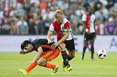 Carlos Soler of Valencia CF Dirk Kuyt of Feyenoord during the preseason friendly match between Feyenoord and Valencia on July 23 2016 at the Kuip in...