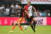 Carlos Soler of Valencia CF Dirk Kuyt of Feyenoord during the preseason friendly match between Feyenoord and Valencia on July 23 2016 at the Kuip in...