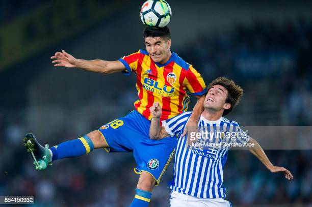 Carlos Soler of Valencia CF duels for the ball with Alvaro Odriozola of Real Sociedad during the La Liga match between Real Sociedad de Futbol and...
