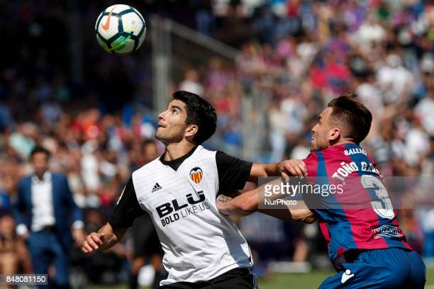 18 Carlos Soler of Valencia CF in action against 03 Antonio Garcia Aranda Tono of Levante Ud during spanish La Liga Santander match between Levante...