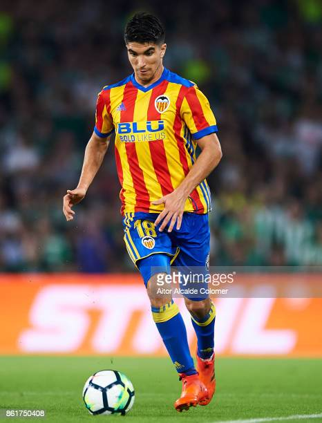 Carlos Soler of Valencia CF in action during the La Liga match between Real Betis and Valencia at Estadio Benito Villamarin on Octob