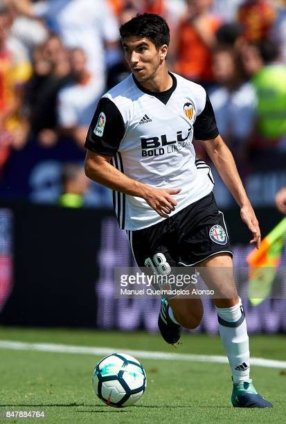 Carlos Soler of Valencia runs with the ball during the La Liga match between Levante and Valencia at Ciutat de Levante Stadium on September 16 2017...