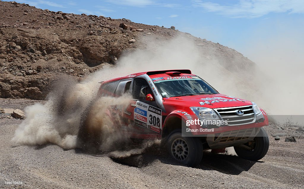 Carlos Sousa and co-pilot Miguel Ramalho of team Great Wall compete in stage 5 from Arequipa to Arica during the 2013 Dakar Rally on January 9, 2013 in Arequipa, Peru.