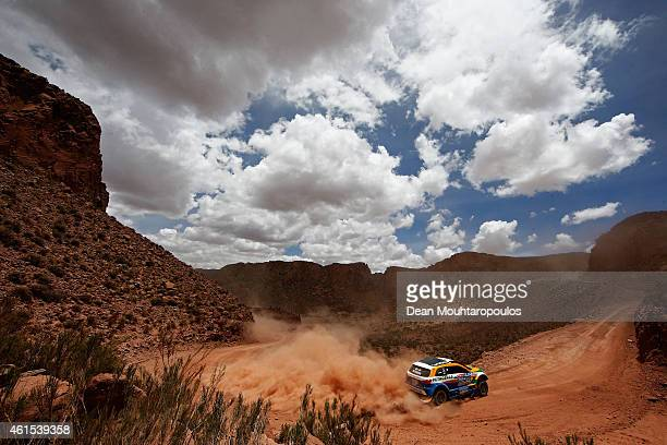 Carlos Sousa and Paulo Fiuza of Portugal driving for the ASX Mitsubishi Petrobras compete near the Salinas Grandes during Stage 10 on day 11 of the...