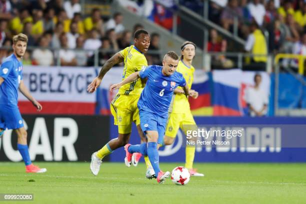 Carlos Strandberg of Sweden and Stanislav Lobotka of Slovakia competes for the ball during the UEFA European Under21 match between Slovakia and...