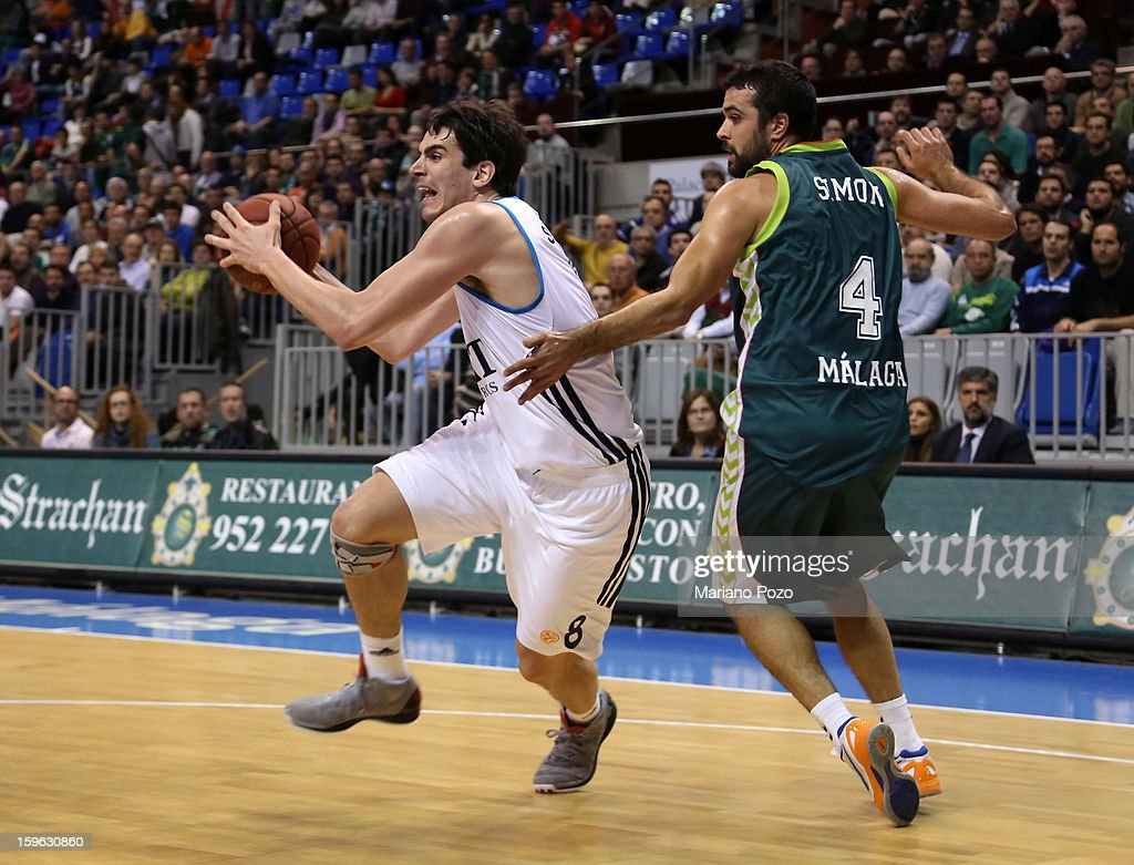 Carlos Suarez, #8 of Real Madrid in action with Krunoslav Simon, #4 of Unicaja Malaga during the 2012-2013 Turkish Airlines Euroleague Top 16 Date 4 between Unicaja Malaga v Real Madrid at Palacio Deportes Martin Carpena on January 17, 2013 in Malaga, Spain.