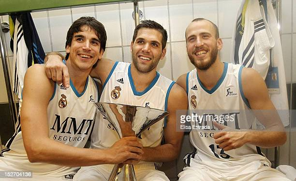 Carlos Suarez Felipe Reyes and Sergio Rodriguez of Real Madrid celebrate with the trophy after winning the Supercopa ACB Final match between Real...