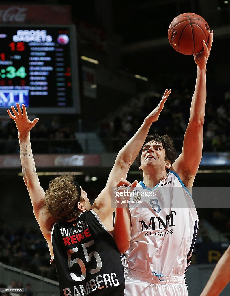 Carlos Suarez of Real Madrid aims to shoot over <a gi-track='captionPersonalityLinkClicked' href=/galleries/search?phrase=Matt+Walsh+-+Basketball+Player&family=editorial&specificpeople=13491253 ng-click='$event.stopPropagation()'>Matt Walsh</a> #55 of Brose Baskets during the Turkish Airlines Euroleague Top 16 game at Palacio de los Deportes on February 28, 2013 in Madrid, Spain.