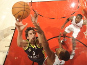 Carlos Suarez of the Real Madrid battle for the ball contol with Dominic McGuire of the Toronto Raptors during the game between the Real Madrid and...