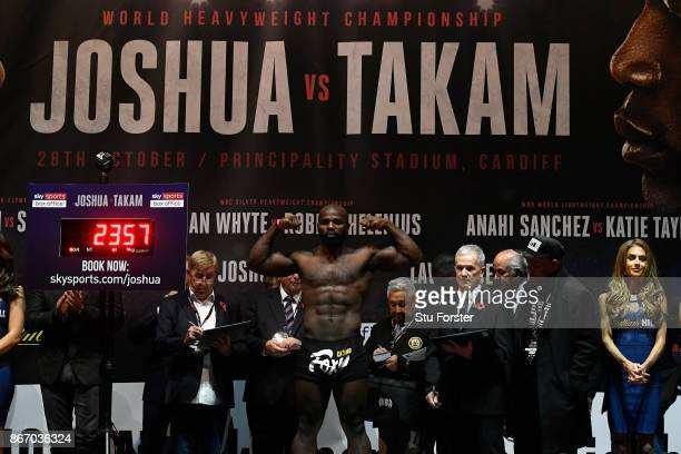 Carlos Takam of France pose for a photo during a weighin prior to tomorrow's world heavyweight title fight between Anthony Joshua and Carlos Takam at...