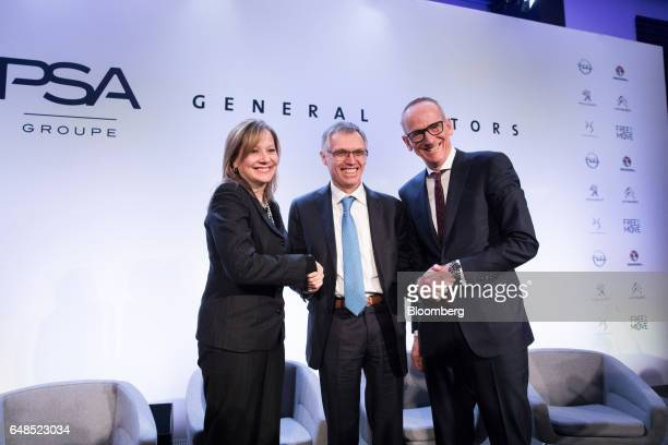 Carlos Tavares chief executive officer of PSA Group centre shakes hands with Mary Barra chairman and chief executive officer of General Motors Co...