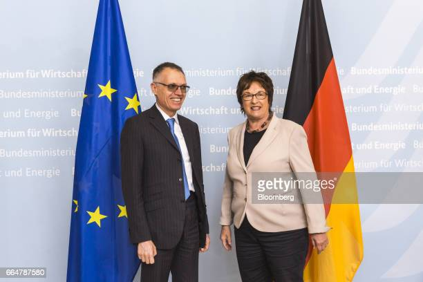 Carlos Tavares chief executive officer of PSA Group left poses for a photograph with Brigitte Zypries Germany's economy and energy minister as he...