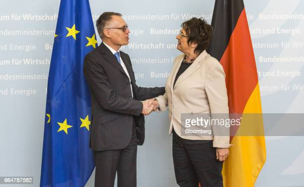 Carlos Tavares chief executive officer of PSA Group left shakes hands with Brigitte Zypries Germany's economy and energy minister as he arrives for...