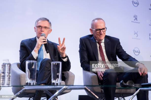 Carlos Tavares chief executive officer of PSA Group left speaks as KarlThomas Neumann chief executive officer of Adam Opel AG listens during the news...
