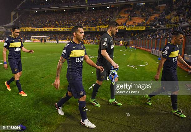 Carlos Tevez and Agustin Orion of Boca Juniors leave the field after a a second leg match between Boca Juniors and Independiente del Valle as part of...