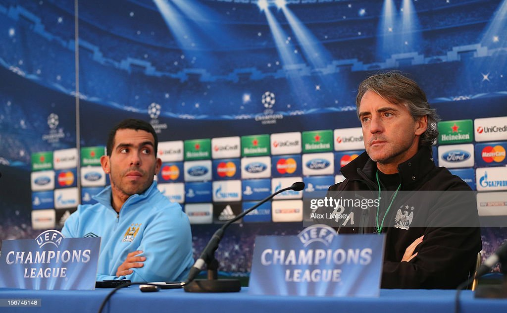 Carlos Tevez and <a gi-track='captionPersonalityLinkClicked' href=/galleries/search?phrase=Roberto+Mancini&family=editorial&specificpeople=234429 ng-click='$event.stopPropagation()'>Roberto Mancini</a> the manager of Manchester City face the media during a press conference at Carrington Training Ground on November 20, 2012 in Manchester, England.