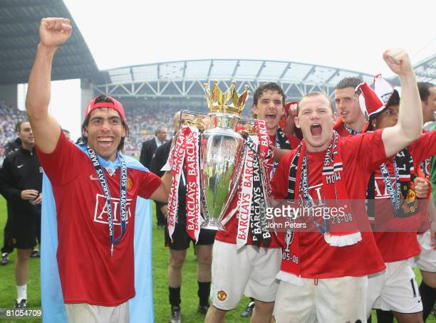 Carlos Tevez and Wayne Rooney of Manchester United celebrates with the Premier League trophy on the pitch after the Barclays FA Premier League match...