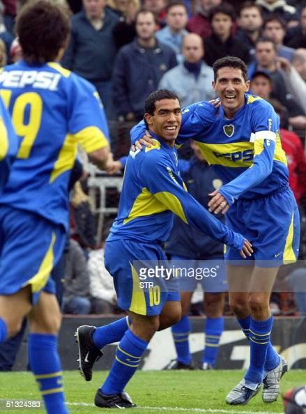 Carlos Tevez Diego Cagna y Raul Cardozo de Boca Juniors festejan el primer gol de su equipo frente a Independiente en Buenos Aires el 19 de setiembre...
