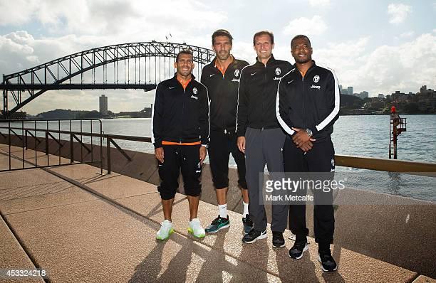 Carlos Tevez Gianluigi Buffon Coach Massimiliano Allegri and Patrice Evra of Juventus pose in front of the Sydney Harbour Bridge during the Juventus...