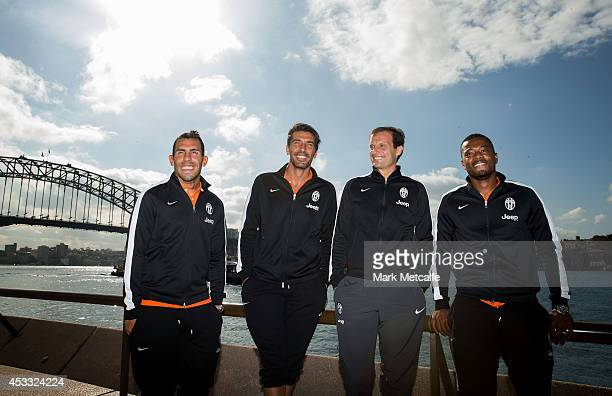 Carlos Tevez Gianluigi Buffon Coach Massimiliano Allegri and Patrice Evra of Juventus pose in front of the Sydney Harbour Bridge during the Juventus...