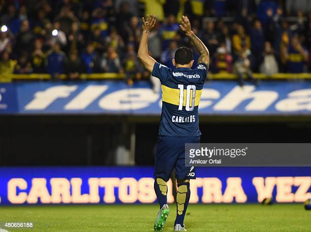 Carlos Tevez greets fans during his presentation as new player of Boca Juniors at Alberto J Armando Stadium on July 13 2015 in Buenos Aires Argentina