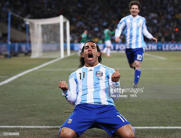 Carlos Tevez of Argentina celebrates scoring during the 2010 FIFA World Cup South Africa Round of Sixteen match between Argentina and Mexico at...