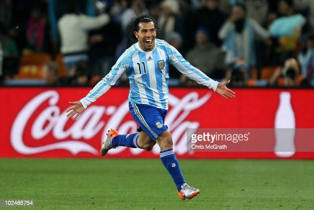 Carlos Tevez of Argentina celebrates scoring his second goal and his side's third during the 2010 FIFA World Cup South Africa Round of Sixteen match...
