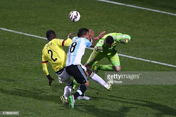 Carlos Tevez of Argentina clashes with David Ospina of Colombia and Cristian Zapata of Colombia during the 2015 Copa America Chile quarter final...