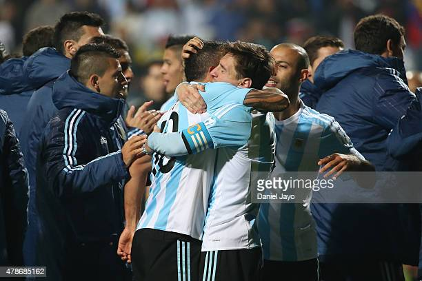 Carlos Tevez of Argentina hugs Lionel Messi after the 2015 Copa America Chile quarter final match between Argentina and Colombia at Sausalito Stadium...