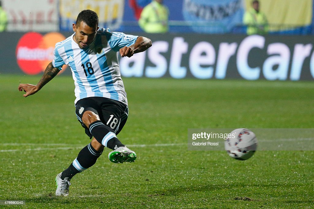 <a gi-track='captionPersonalityLinkClicked' href=/galleries/search?phrase=Carlos+Tevez&family=editorial&specificpeople=220555 ng-click='$event.stopPropagation()'>Carlos Tevez</a> of Argentina takes the seventh penalty kick in the penalty shootout during the 2015 Copa America Chile quarter final match between Argentina and Colombia at Sausalito Stadium on June 26, 2015 in Viña del Mar, Chile.