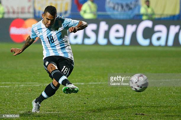 Carlos Tevez of Argentina takes the seventh penalty kick in the penalty shootout during the 2015 Copa America Chile quarter final match between...