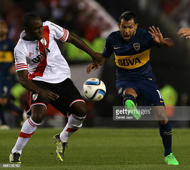 Carlos Tevez of Boca Juniors and Eder Alvarez Balanta of River Plate vie for the ball during a match between River Plate and Boca Juniors as part of...