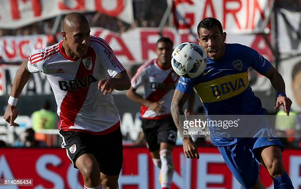 Carlos Tevez of Boca Juniors and Jonatan Maidana of River Plate go for the ball during a match between River Plate and Boca Juniors as part of sixth...