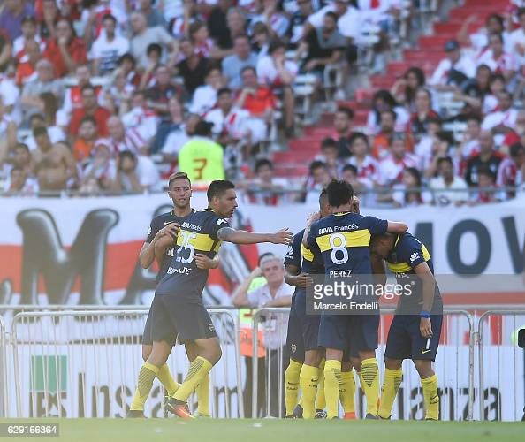 Carlos Tevez of Boca Juniors and teammates celebrate after scoring the third goal of his team during a match between River Plate and Boca Juniors as...