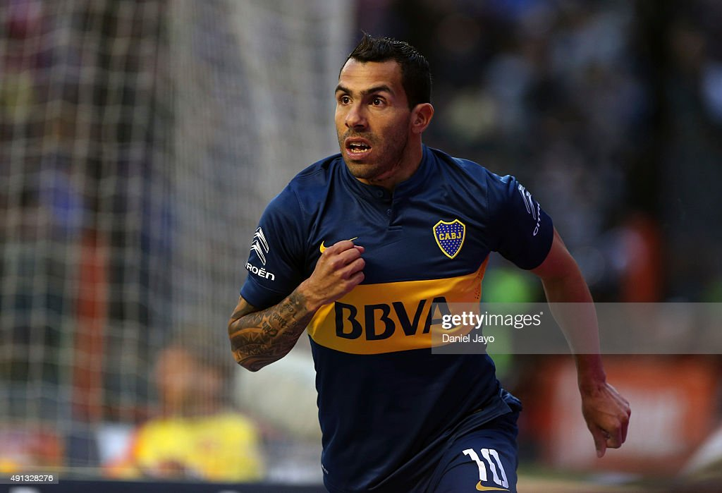 <a gi-track='captionPersonalityLinkClicked' href=/galleries/search?phrase=Carlos+Tevez&family=editorial&specificpeople=220555 ng-click='$event.stopPropagation()'>Carlos Tevez</a> of Boca Juniors celebrates after forcing an own goal by Gabriel Tomassini of Crucero del Norte during a match between Boca Juniors and Crucero del Norte as part of 27th round of Torneo Primera Division 2015 at Alberto JoseŽ Armando Stadium on October 04, 2015 in Buenos Aires, Argentina.