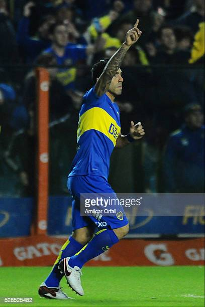 Carlos Tevez of Boca Juniors celebrates after scoring the first goal of his team by a penalty kick during a second leg match between Boca Juniors and...