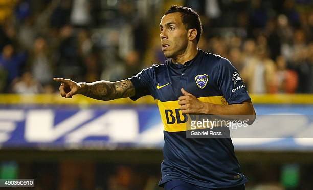 Carlos Tevez of Boca Juniors celebrates after scoring the third goal of his team during a match between Boca Juniors and Banfield as part of 26th...