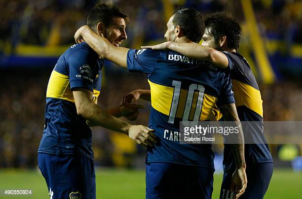 Carlos Tevez of Boca Juniors celebrates with his teammates after scoring the third goal of his team during a match between Boca Juniors and Banfield...
