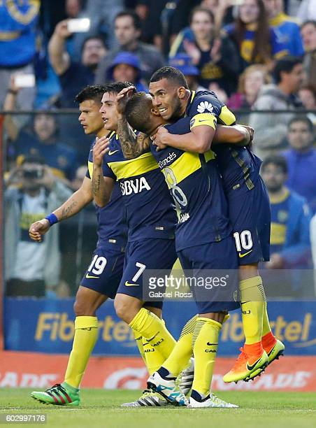 Carlos Tevez of Boca Juniors celebrates with teammates after scoring the opening goal during a match between Boca Juniors and Belgrano as part of...