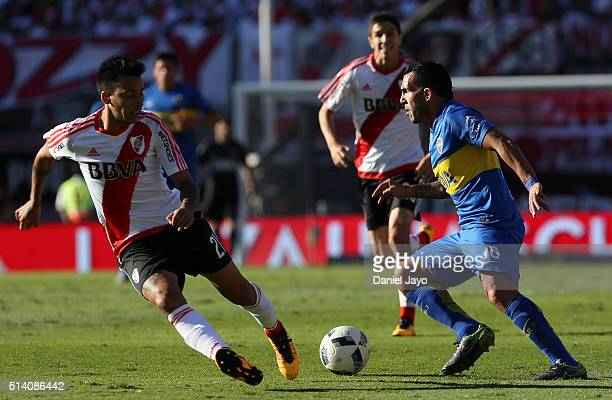Carlos Tevez of Boca Juniors dribbles past Leonel Vangioni of River Plate during a match between River Plate and Boca Juniors as part of sixth round...