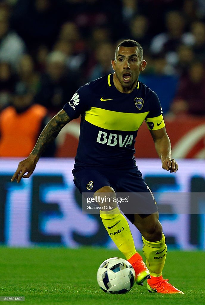 Carlos Tevez of Boca Juniors drives the ball during a match between Lanus and Boca Juniors as part of first round of Campeonato de Primera Division...