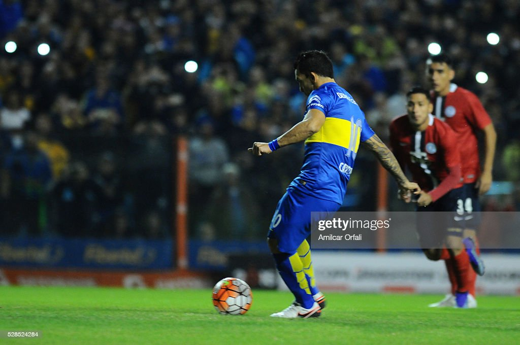 <a gi-track='captionPersonalityLinkClicked' href=/galleries/search?phrase=Carlos+Tevez&family=editorial&specificpeople=220555 ng-click='$event.stopPropagation()'>Carlos Tevez</a> of Boca Juniors kicks to score from the penalty spot during a second leg match between Boca Juniors and Cerro Porteno as part of round of sixteen of Copa Bridgestone Libertadores 2016 at Alberto J Armando Stadium on May 05, 2016 in Buenos Aires, Argentina.