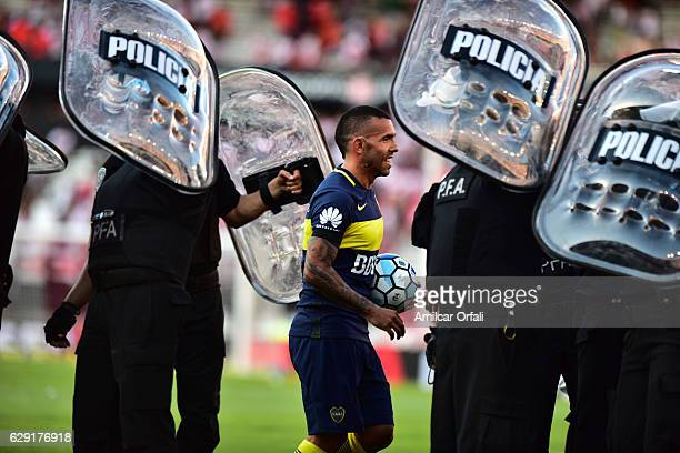Carlos Tevez of Boca Juniors leaves the field with the ball after winning the match between River Plate and Boca Juniors as part of Torneo Primera...