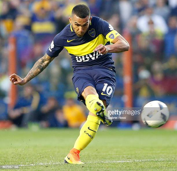 Carlos Tevez of Boca Juniors shoots to score the opening goal during a match between Boca Juniors and Belgrano as part of second round of Campeonato...