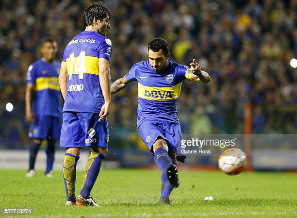 Carlos Tevez of Boca Juniors takes a free kick to score the fourth goal of his team during a match between Boca Juniors and Deportivo Cali as part of...