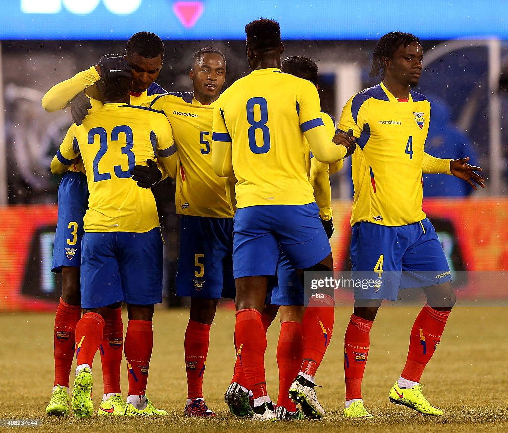 Carlos Tevez of Ecuador is congratulated by Nicolas Otamendi and the rest of his teammates after he scored a goal in the first half against Argentina...