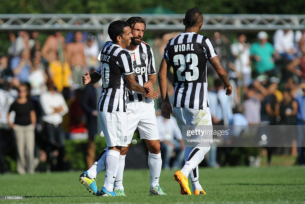 Carlos Tevez (L) of FC Juventus celebrates with his teammates after scoring during the pre-season friendly match between FC Juventus A and FC Juventus B on August 11, 2013 in Villar Perosa near Pinerolo, Italy.