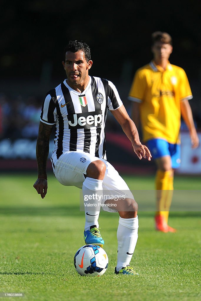 Carlos Tevez of FC Juventus in action during the pre-season friendly match between FC Juventus A and FC Juventus B on August 11, 2013 in Villar Perosa near Pinerolo, Italy.