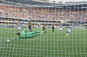 Carlos Tevez of Hellas Verona FC misses to convert a penalty kick during the Serie A match between Hellas Verona FC and Juventus FC at Stadio...